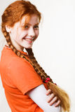 Lovely redhead girl with long braids Royalty Free Stock Photography