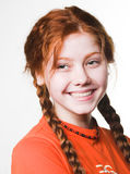 Lovely redhead girl with long braids Royalty Free Stock Photo