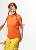 Lovely redhead girl with long braids Stock Images