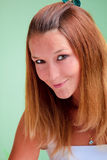Lovely redhead on green background Stock Image