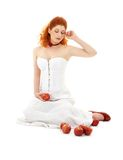 Lovely redhead in red shoes with apples Royalty Free Stock Photo