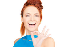 Lovely redhead showing ok sign Stock Photography