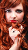 Lovely redhead - Young beautiful red haired woman. Blue eye Royalty Free Stock Photography
