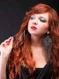 Lovely redhead - Young beautiful red haired woman Royalty Free Stock Images