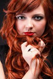 Lovely redhead - Young beautiful red haired woman Royalty Free Stock Image