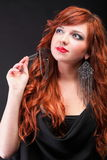 Lovely redhead - Young beautiful red haired woman Royalty Free Stock Photos