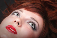 Lovely redhead - Young beautiful red haired woman. Blue eye Royalty Free Stock Photo