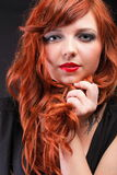 Lovely redhead - Young beautiful red haired woman Royalty Free Stock Photography