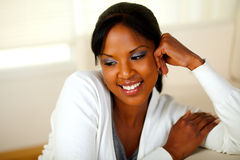 Lovely relaxed girl smiling and looking down Stock Image