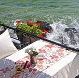 Lovely restaurant near rocky shores Royalty Free Stock Photo