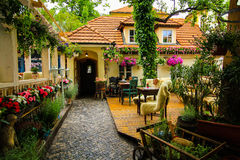 Lovely restaurant. Outdoor seat of restaurant or coffee shop decorated with flower and plants Royalty Free Stock Photo
