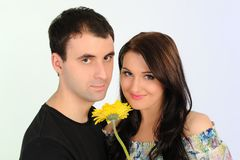 Lovely romantic couple with flower embracing Stock Photo