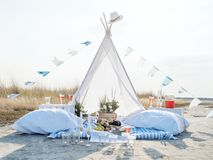 Romantic Camping Trip for Two. Lovely romantic glamping for two on a wild seashore. Unique way to celebrate your love Stock Image