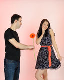 Lovely romantic man giving flower to a woman Stock Images