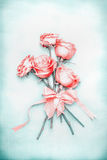 Lovely romantic roses bunch with ribbon on blue background in pastel color Stock Photography