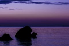 Lovely and romantic sunset view. On a south Italian sunset sea shore royalty free stock photo