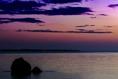 Lovely and romantic sunset view. On a south Italian sunset sea shore royalty free stock photos