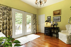 Lovely room with brilliant yellow walls. Royalty Free Stock Photos