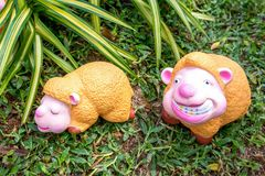 Lovely rubber sheep doll in a garden, Sheep toy. At lawn background royalty free stock photo