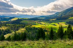 Lovely rural area in mountains. Huge cloud formation over the distant ridge. picturesque scenery of Carpathian alps royalty free stock photos
