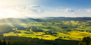 Lovely rural countryside in beautiful sunlight. Pasture landscape with barnyards. Peaceful atmosphere of a typical bavarian cultured landscape Stock Photos