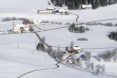 Lovely rural countryside on snowy winter day. Aerial view of barnyards and farm. Weitnau, Allgau, Bavaria, Germany. Stock Photography