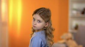Lovely sad little girl looking to camera, family problems, adoption program. Stock photo stock photos