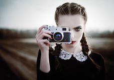 Free Lovely Sad Young Girl Photographing On Vintage Film Camera. Closeup Outdoor Portrait Royalty Free Stock Photography - 100507537