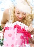 Lovely santa helper girl with christmas gifts Royalty Free Stock Images