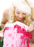 Lovely santa helper girl with christmas gifts Stock Photos