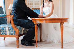 Lovely scene of bride and groom Stock Photos