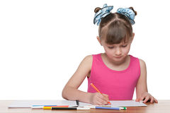 Lovely schoolgirl at the desk Royalty Free Stock Image