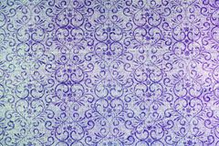 Classic damask patterned background. A lovely seamless pattern of a grey and blue background of abstract repeat  of leaf shapes on paper Royalty Free Stock Photos