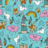 Lovely seamless pattern with hand-drawn unicorns and cute doodles.  Royalty Free Stock Image