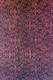 Classic damask patterned background. A lovely seamless pattern of a pink and black background of abstract repeat  of leaf shapes on paper Royalty Free Stock Photography