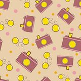 Lovely seamless pattern with sunglasses and cameras. Beige background Royalty Free Stock Image