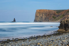 Lovely seascape in a long exposure. Stone needle, Portugal. Royalty Free Stock Photos