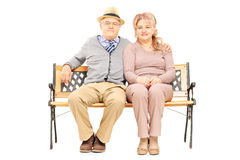 Lovely senior couple sitting on bench Stock Photos