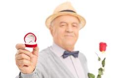 Lovely senior gentleman holding an engagement ring Royalty Free Stock Image