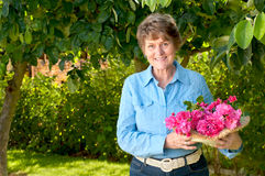 Lovely Senior in Her Garden with Pink Rose Bouquet Royalty Free Stock Images