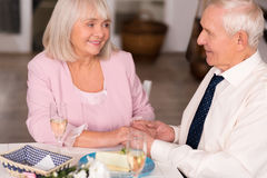 Lovely senior lady gazing at her gentleman with love Stock Photo