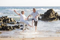 Lovely senior mature couple on their 60s or 70s retired walking Stock Photography