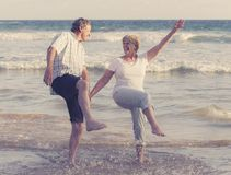 Lovely senior mature couple on their 60s or 70s retired walking Stock Photo
