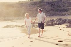 Lovely senior mature couple on their 60s or 70s retired walking Royalty Free Stock Photos