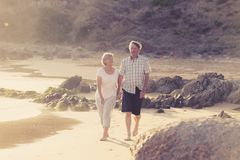 Lovely senior mature couple on their 60s or 70s retired walking Royalty Free Stock Photography