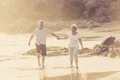 Lovely senior mature couple on their 60s or 70s retired walking Royalty Free Stock Photo