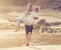 Lovely senior mature couple on their 60s or 70s retired walking Stock Images