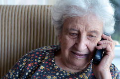 Lovely senior woman on phone Royalty Free Stock Images