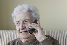 Lovely senior woman on phone Stock Photos