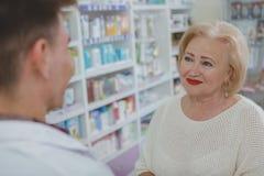 Lovely senior woman shopping at drugstore stock image